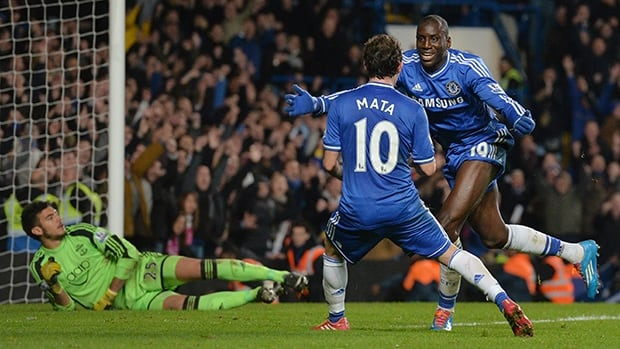 Chelsea's Demba Ba, right, celebrates with teammate Juan Mata after a goal against Southampton at Stamford Bridge in London, on December 1, 2013.
