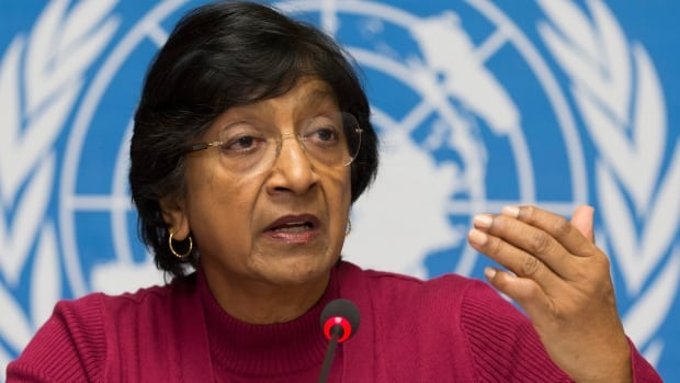 "UN High Commissioner for Human Rights Navi Pillay speaks at a news conference at the United Nations in Geneva Monday. She said a UN panel investigating abuses in Syria's civil war has produced ""massive evidence"" of crimes that ""indicates responsibility at the highest level of government, including the head of state."""
