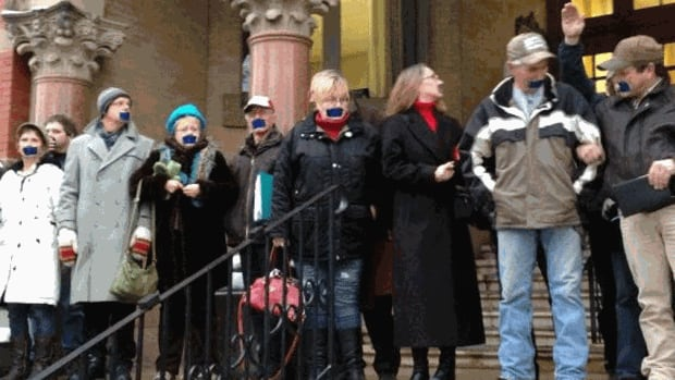 Anti-shale gas protesters wore tape over the mouths after a judge granted SWN Resources Canada an extension on its injunction.