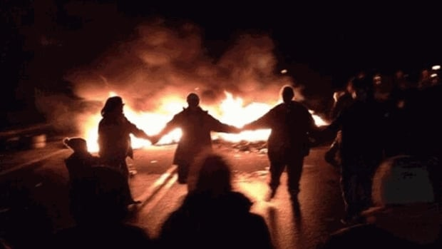 Anti-shale gas protesters danced around a tire fire on Highway 11 near Rexton on Monday night.