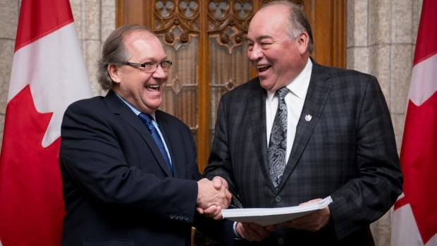 Bernard Valcourt, Minister of Aboriginal Affairs and Northern Development, poses with Northwest Territories Premier Bob McLeod in the foyer of the House of Commons after the introduction of Bill C-15, the Northwest Territories Devolution Act.