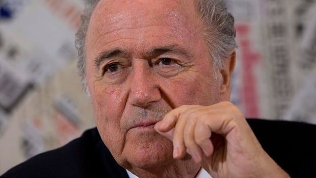 FIFA president Sepp Blatter says the decision to change the World Cup draw format followed talks with confederation presidents, including UEFA's French President Michel Platini.