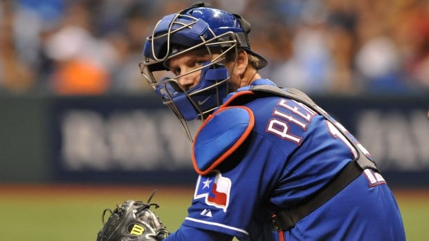 Catcher A. J. Pierynski, seen here with the Texas Rangers, has reportedly signed on with the Boston Red Sox on a one-year deal.