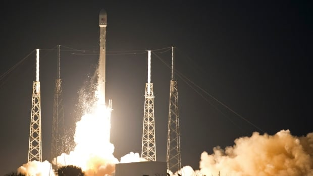A Falcon 9 SpaceX rocket lifts off from Launch Complex 40 at the Cape Canaveral Air Force Station in Cape Canaveral, Fla., on Monday. The rocket carries its first commercial payload, a communications satellite.