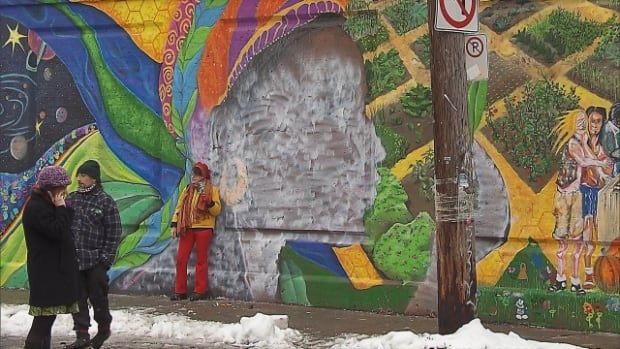 Vandals painted over the face of a black woman on a mural in Pointe-Saint-Charles.
