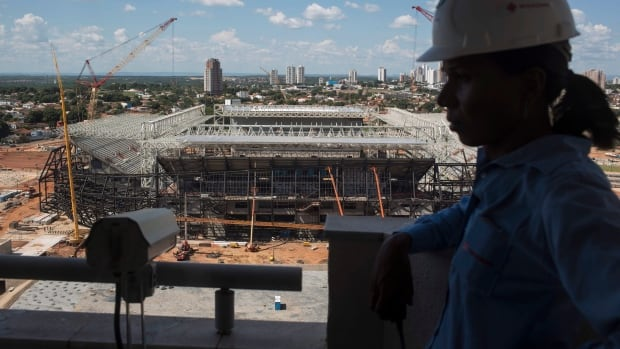 Building permits have increased in eight of the 10 months in 2013. (Felipe Dana/Associated Press)