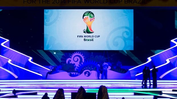 Workers stand on the stage where soccer's World Cup draw will take place in Costa do Sauipe, Brazil, on Friday at 11 a.m. ET. It will be streamed live at CBCSports.ca.