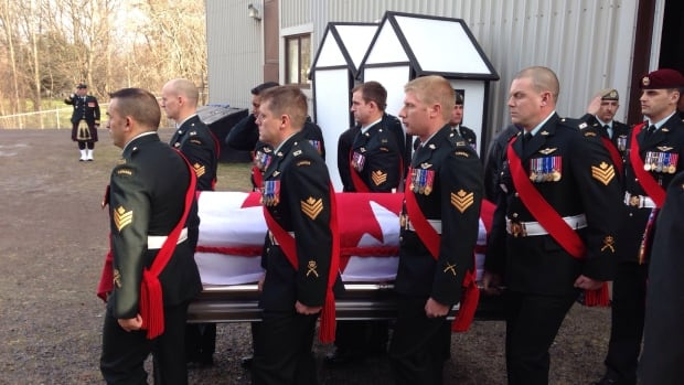 Military personnel and civilians from the area packed into the Truro Armoury for the funeral.