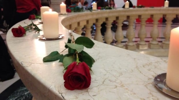 A rose and candle, 14 of each, are placed at the rotunda of the Manitoba legislative building in memory of the 14 women killed on Dec. 6, 1989, at Montreal's École Polytechnique.