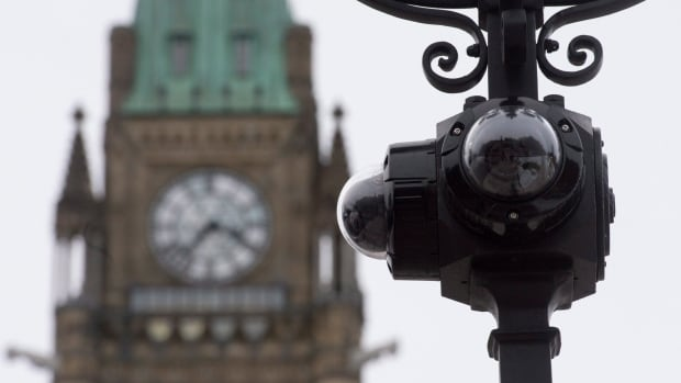 Security cameras are seen on a lightpost following renovations to the entranceways to Parliament Hill. The RCMP have recently added new video cameras near pedestrian entrances and a vehicle screening facility along the boulevard in front of the Parliament Buildings.