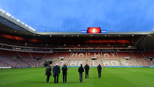 Officials inspect the pitch ahead of the Barclays Premier League match between Sunderland and Tottenham Hotspur on December 07, 2013 in Sunderland, England.
