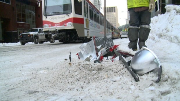 A collision between a C-Train and car in the city core was one of several accidents reported on Sunday.