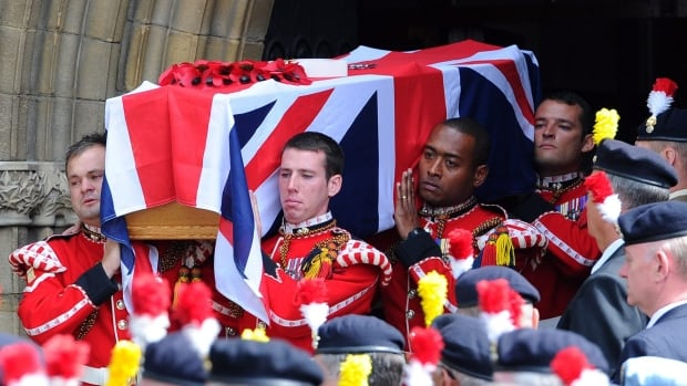 Fusilier Lee Rigby was knocked down by a car on a London street and then hacked to death with a meat cleaver and knives on May 22. Two men were found guilty of his murder on Thursday. Rigby's funeral, above, was held at Bury Parish church in Greater Manchester in July.