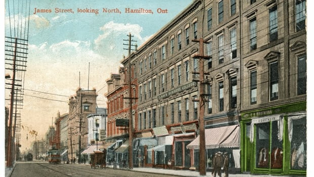 This postcard view shows the Thomas Building between the two utility poles. To the right is the old Lister Building, destroyed by fire in 1923 and replaced the next year by the Lister Block that stands today.