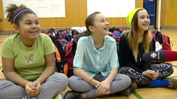 Students at Rosemont School in Calgary's northwest happily talk about their donation to Stephen's Backpacks.
