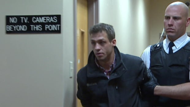 Dwight Saunders is escorted from provincial court in St. John's on Tuesday.
