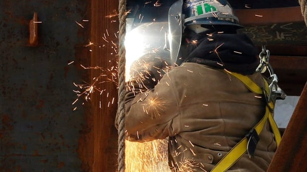 A welder at work. The most promising sector for new jobs in Canada in 2014 is construction, a survey by the Manpower Group shows.