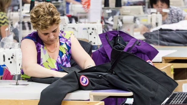 A Canada Goose employee sews a jacket at the company's factory in Toronto. The company is a frequent target of counterfeiters.