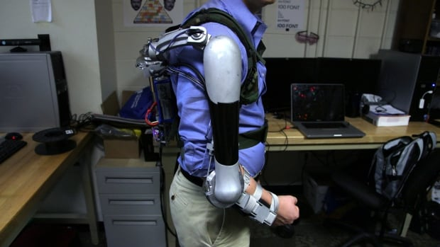 Engineering student Nick McGill wears the Titan Arm, which he invented with three classmates at the University of Pennsylvania.