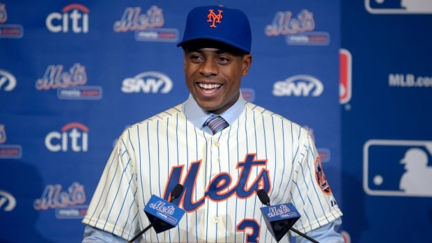 New York Mets outfielder Curtis Granderson is introduced at a news conference announcing his signing at baseball's winter meetings in Lake Buena Vista, Fla., on Tuesday. The former Yankees' outfielder had some interesting comments about New York fans.