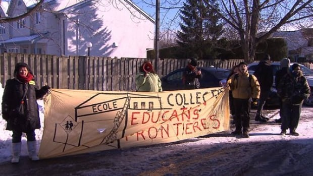Members of the Collectif éducation sans frontières protested for several hours outside the office of Quebec education minister, Marie Malavoy.