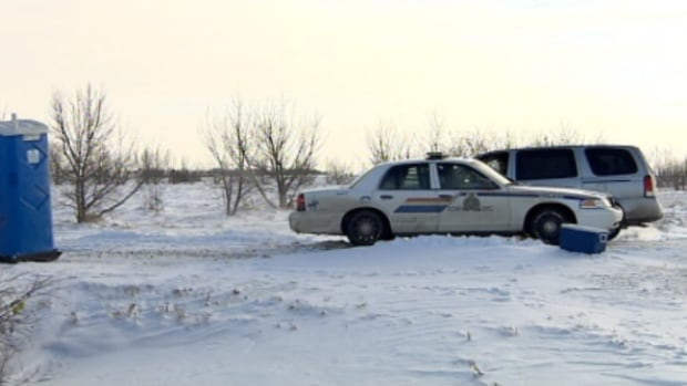 An RCMP cruiser sits near a house that caught on fire near Castor, Alta. a week ago.