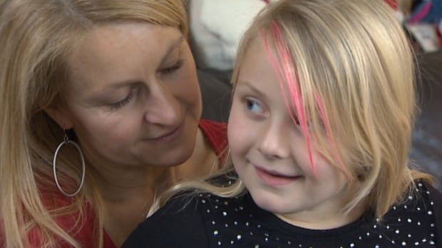 Seven-year-old Carys Nurse with her mother, Stacey. The Nurse family is trying to find a way to access a breakthrough drug to treat the girl's cystic fibrosis.