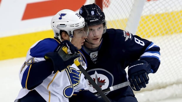 St. Louis Blues' Alexander Steen, left, and Winnipeg Jets' Jacob Trouba battle in front of the Jets' net during the first period Tuesday at the MTS Centre.
