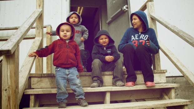 This family in Attawapiskat, Ont., lived in a temporary shelter that was evacuated after a recent fire.
