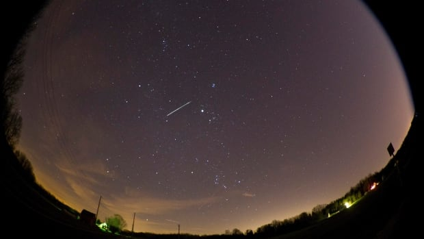 A meteor streaks across the sky near Lafayette, Ind., during last year's annual Geminid meteor shower. This year's meteor shower will peak Friday night.