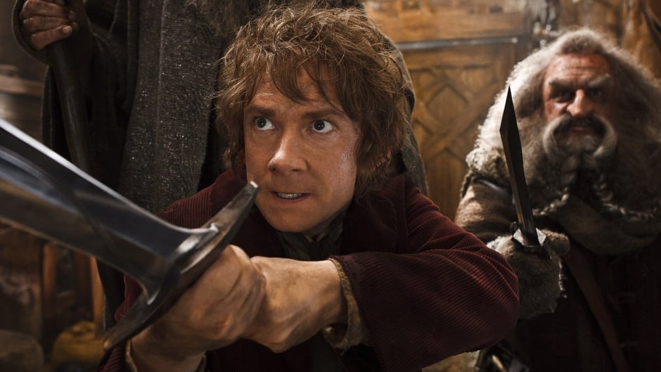 This image released by Warner Bros. Pictures shows Martin Freeman, left, and John Callen in a scene from The Hobbit: The Desolation of Smaug. Harvey and Bob Weinstein have sued Warner Bros.' New Line Cinema claiming they're owned a share of the profits from the second and third Hobbit films.