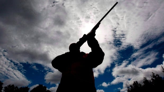 "A rifle owner checks the sight of his rifle at a hunting camp property in rural Ontario west of Ottawa, Sept. 15, 2010. The Canadian Sports Shooting Association has launched a national petition that asks Ottawa to establish a single ""civilian agency"" in place of provincial and territorial firearms officers that oversee licensing and other gun regulations."