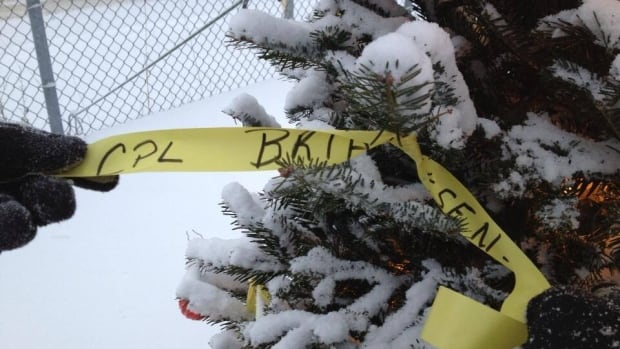 A yellow ribbon in memory of the late Cpl. Brian Pinksen was added to the Christmas tree outside the Gallipole Armoury in Corner Brook.
