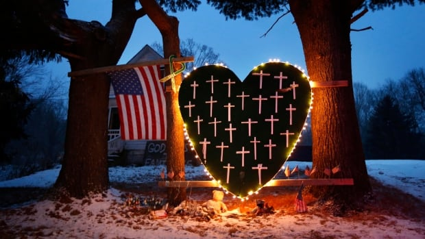 A makeshift memorial with crosses for the victims of the Sandy Hook massacre stands outside a home in Newtown, Conn., on Dec. 14, 2013, the one-year anniversary of the shootings. A new study shows the U.S. leads the world in mass shootings.