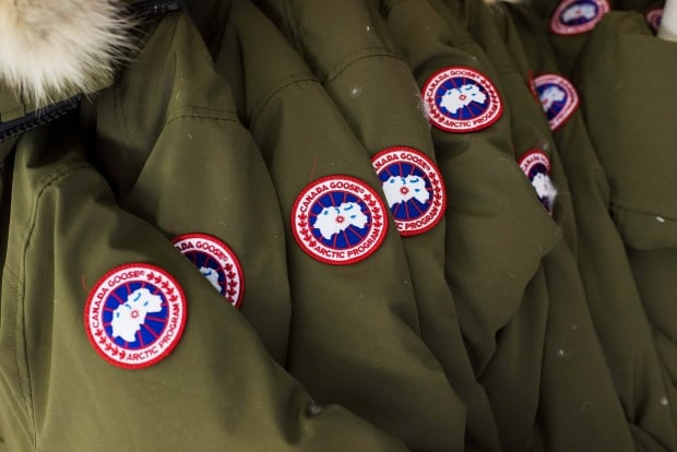 Canada Goose jackets on a factory rack