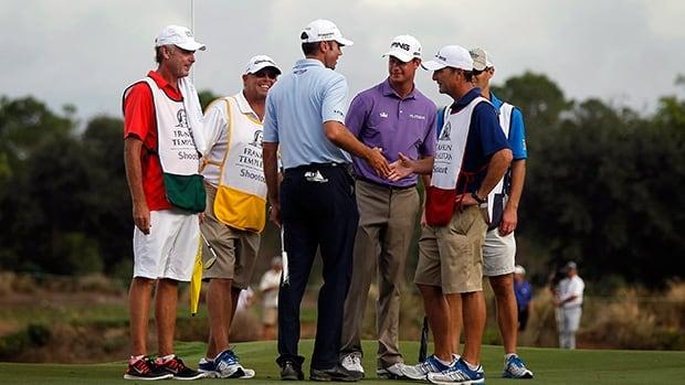Matt Kuchar, centre, and Harris English, centre right, celebrate after the second round Saturday, Dec. 14, 2013, at Tiburon Golf Club in Naples, Fla.
