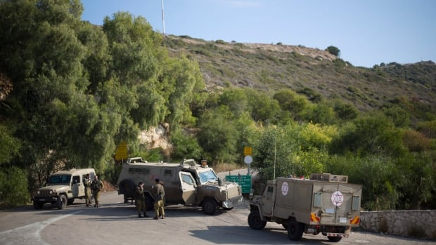 Israeli soldiers guard near the border between northern Israel and Lebanon on Monday. Israel's army said Monday its troops shot two Lebanese soldiers, hours after a Lebanese army sniper killed an Israeli soldier as he drove along the border.