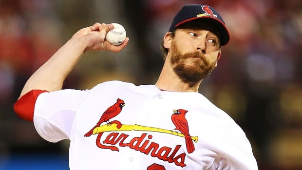 Canadian closer John Axford pitched in a late-inning relief role with the Cardinals late last season following a trade from Milwaukee in August.
