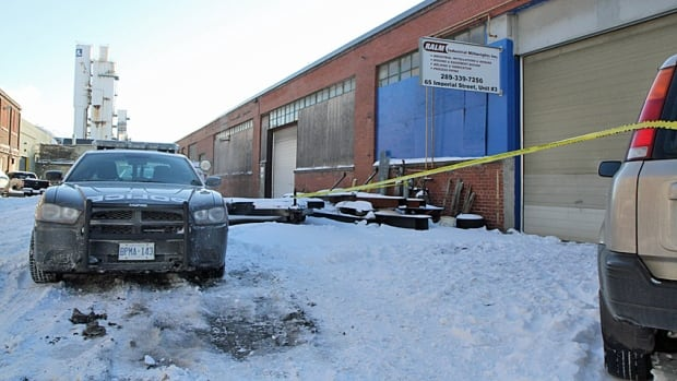 The site outside Ralm Industrial Millwrights Inc. was still cordoned off with police tape on the Monday morning after a child was killed inside on Sunday, Dec. 15, 2013.