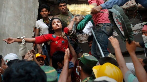 A woman is lifted out of the rubble of the Rana Plaza factory collapse in Dhaka, Bangladesh, that killed 1,129 people in 2013. Clothes bound for Canada were made in the factory.