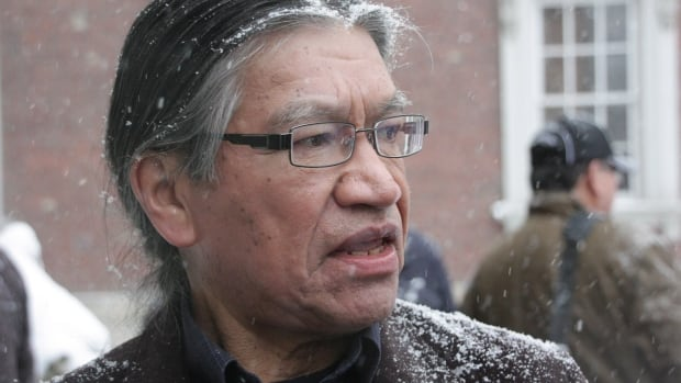 Edmund Metatawabin, 66, a survivor of St. Anne's Residential School in Fort Albany, Ont., speaks outside Osgoode Hall in Toronto on Tuesday. Metatawabin remembers being shocked in an electric chair at the school.
