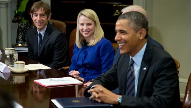 U.S. President Barack Obama meets with technology executives in the Roosevelt Room of the White House on Tuesday. From left are Mark Pincus, founder, chief product officer and chairman, Zynga, and Marissa Mayer, president and CEO, Yahoo.