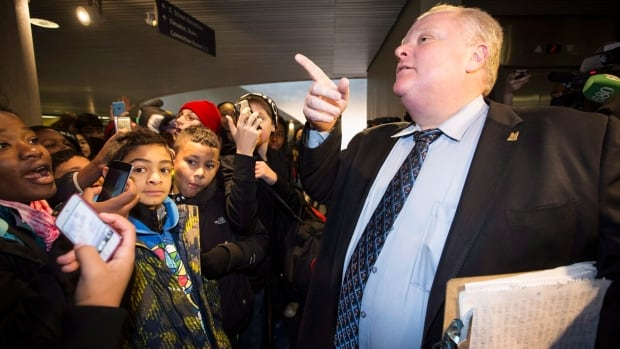 Toronto Mayor Rob Ford arrives at city hall as he invites a group of school children into his office in Toronto, Friday December 13, 2013.