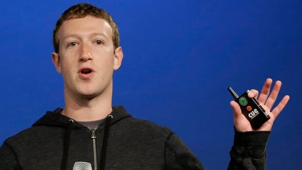Facebook CEO Mark Zuckerberg, shown March 20, is being sued by a group of investors who claim the company hid the risks of its move to mobile ads ahead if its 2012 IPO.