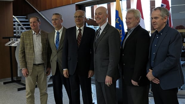 The federal government will contribute up to $23 million to Hamilton's new sewage treatment facility. Attending the announcement were, from left, Coun. Lloyd Ferguson; Dan McKinnon, director of Hamilton water; Mayor Bob Bratina; MP David Sweet; Gerry Davis, general manager of public works, and city manager Chris Murray.