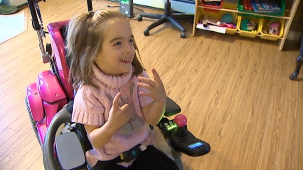 Payton Given, 5, shows off her wheelchair Wednesday. The girl has cerebral palsy.