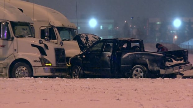 A woman driving a pickup truck lost control of the vehicle, and it went into oncoming traffic Wednesday night. It hit at least one semi-truck.