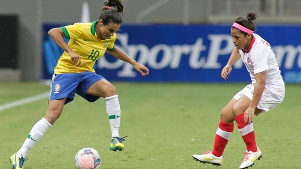 Brazil's Marta Vieira, left, takes control of the ball as Canada's Desiree Scott looks on.