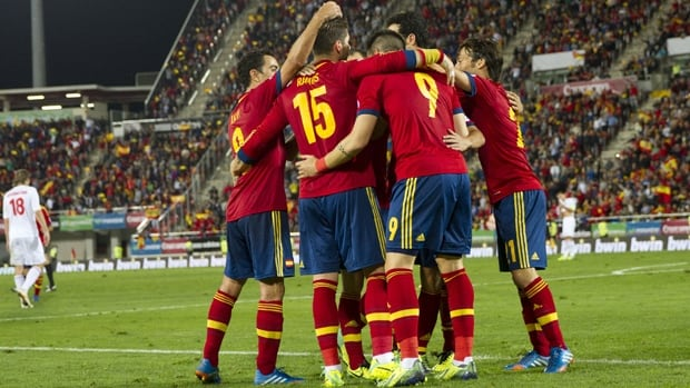 Members of Spain celebrate a 2-1 win over Belarus in World Cup qualifying at Iberostar Stadium in Palma de Mallorca on Oct. 11.