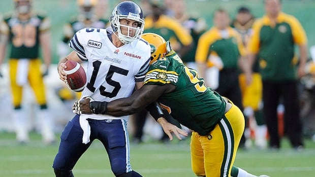 Eskimos defensive tackle Almondo Sewell, right, has had his contract extended through the 2015 CFL season. He posted eight sacks, 39 tackles and one pass knockdown this past season.